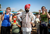 Unidentified tourists and winner of the moustache contest at the Pushkar fair. — Stock Photo