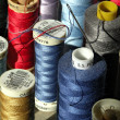 Closeup of colorful cotton reels — Stock Photo