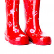 A pair of bright red gumboots — Stock Photo