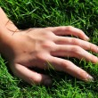 Hand in grass — Stock Photo