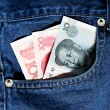 Chinese money in jeans pocket — Stock Photo