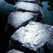 Stock Photo: Stone path across tranquil pond