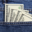 Hundred dollar notes in jeans pocket — Stock Photo