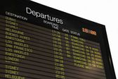 Airport departure board at Auckland airport — Stock Photo