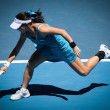 MELBOURNE, AUSTRALIA - JANUARY 26: Jie Zheng in action at her quarter final win over Maria Kirilenko during the 2010 Australian Open — Stock Photo