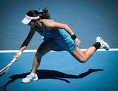 MELBOURNE, AUSTRALIA - JANUARY 26: Jie Zheng in action at her quarter final win over Maria Kirilenko during the 2010 Australian Open — Photo