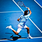 MELBOURNE, AUSTRALIA - JANUARY 25: Roger Federer in his win over Lleyton Hewitt during the 2010 Australian Open — Stock Photo