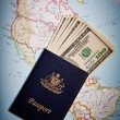 Australipassport and US banknotes with Map background — Stock Photo #30910419