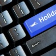 Blue HOLIDAY button on a computer keyboard — Stock Photo