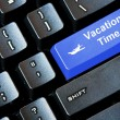 Blue VACATION TIME button on a computer keyboard — Stock Photo