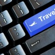 Blue TRAVEL button on a computer keyboard — Stock Photo