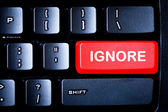 Red IGNORE button on a computer keyboard — Stock Photo