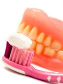 Toothpaste, toothbrush, yellow teeth — Stock Photo