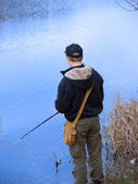 Young angler fishing — Stock Photo