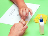 Hands that make applique — Stock Photo