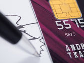 Credit card and signature — Stock Photo