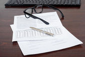 Business papers, pen and glasses — Stockfoto