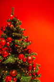 Beautiful Christmas tree on red background. — Stock Photo