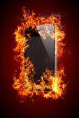 Black Smartphone  in fire — Stock Photo