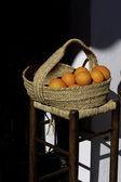 Oranges and basket — Stock Photo