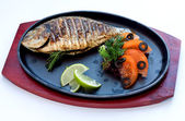Fried river fish a grill — Stock Photo