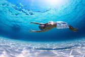 Young man diving on a breath — Stock Photo