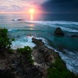 Sunset over rocky coast of Indian Ocean. — Stock Photo