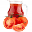 Tomatoes and a pitcher — Stock Photo