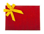 Red box with a yellow bow — Foto de Stock