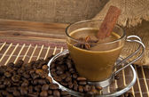 Cup of coffee over grains — Stock Photo