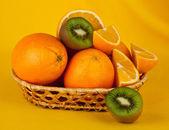 Oranges and kiwi — Stock Photo