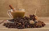 Cup of coffee and grains — Stock Photo
