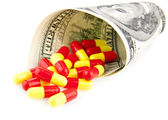 Pills and dollars — Stock Photo