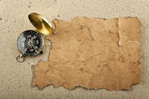 Compass and the old paper — Stock Photo