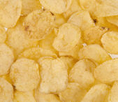 Chips as background — Stock Photo