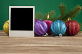 Christmas still life with a photo — Stock Photo
