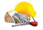 Helmet, brick and meter — Stock Photo