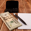 Stock Photo: Dollars,paper and a pen