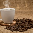 Stock Photo: Cup of coffee and grain