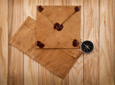 Old envelopes and compass — Stock Photo