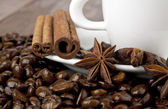Cup of coffee and seasoning — Stock Photo