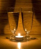 świeca i okulary — Zdjęcie stockowe