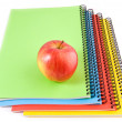 Notebooks and apple — Stock Photo