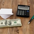 Stock Photo: Dollars, paper and a pen