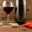 Stock Photo: Glass of wine and bottle