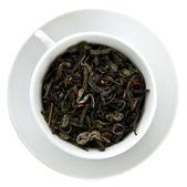 Negro hojas de té en la taza de té — Foto de Stock