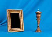 Wooden photo frame and candle — Stock Photo