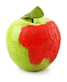 Green apple painted in red — Stock Photo