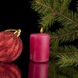 Candle and Christmas ornament — Stock Photo #40664769