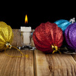 Candle and Christmas ornament — Stock Photo